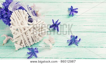 Hyacynths Flowers And Decorative Heart On Wooden Table
