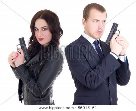 Young Man In Business Suit And Elegant Woman With Guns Isolated On White