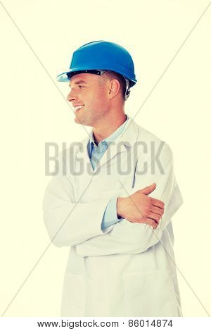 Man in a lab coat and helmet, engineer, teacher or chemical looking on copy space