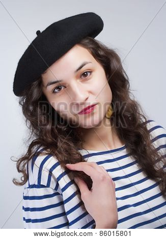 Young Beautiful Woman With French Style Beret And Striped T-shirt