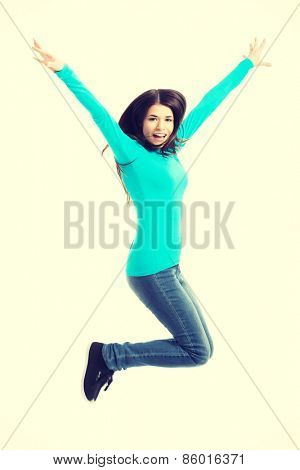 Young casual woman, student jumping. Isolated on white.