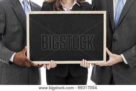 Business people holding blackboard