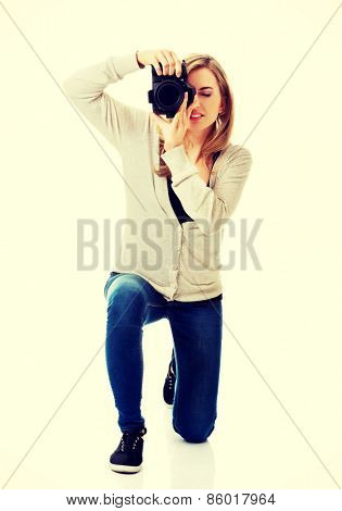 Woman photographer at work with DSLR
