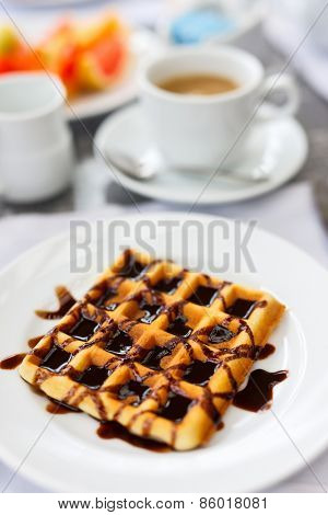 Delicious waffles with coffee served for breakfast at resort restaurant