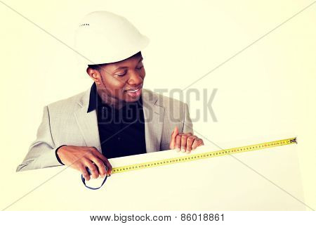 Engineer or architect man showing blank sign board