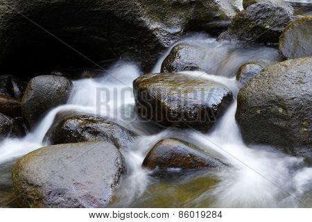 Water flowing between rocks in stream