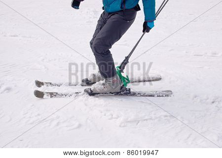 A Skier Descends From The Mountain