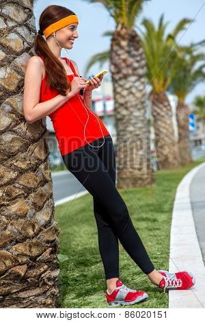 Runner near the palm tree