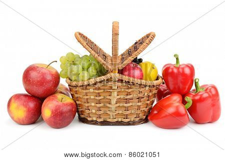 vegetables and fruits in basket isolated on white