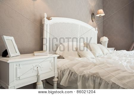 Comfortable Bed In A Bedroom