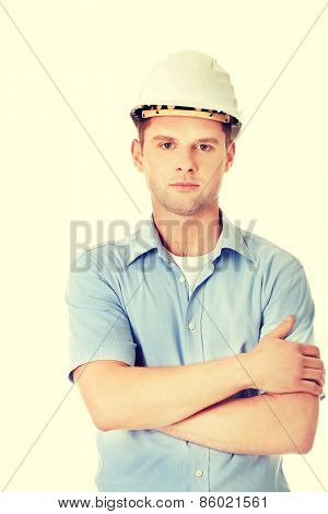 Portrait of an handsome engineer in helmet