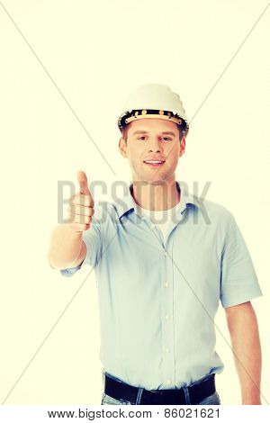 Portrait of a builder in a white helmet gesturing OK