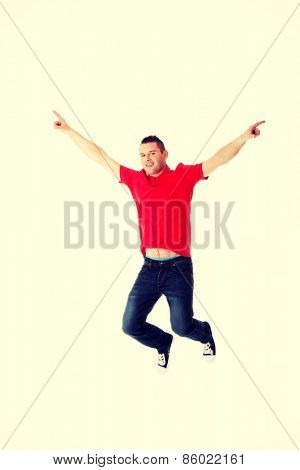 Young casual man jumping in air.