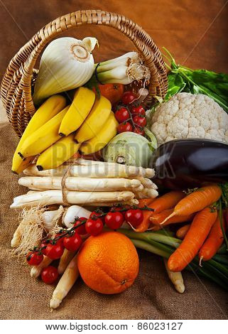 Basket full of various fresh organic vegetables and fruits from the garden
