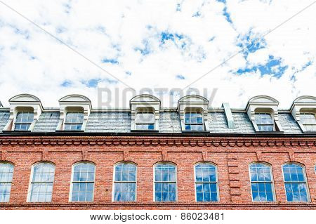 Clouds Over Mansard Roof