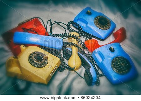 Old Broken Phones, Photo In Old Style Image.
