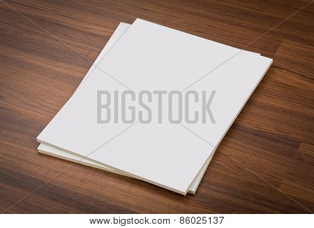 Blank catalog, magazines,book mock up on wood background , with clipping path
