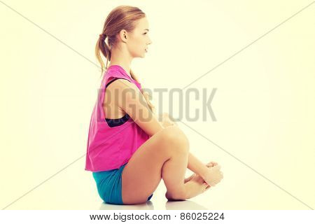 Sport fitness woman, young healthy girl doing stretching exercises