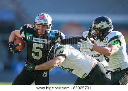 INNSBRUCK, AUSTRIA - MARCH 29, 2014: WR Adrian Platzgummer (#5 Raiders) runs with the ball in an AFL football game.