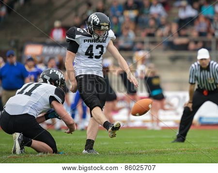 GRAZ, AUSTRIA - APRIL 04, 2014: K Marek Hrubon (#43 Panthers) kicks the ball in an AFL football game.