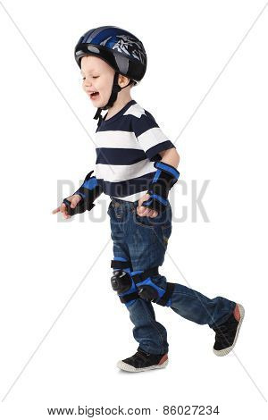Little Boy In Protection Helmet And In The Knee And Arm Ruffles Runs And Laughs