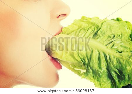 Portrait of attractive smiling woman eating salat