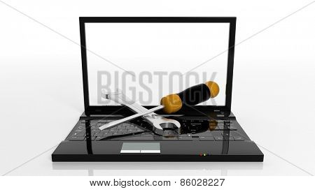 Screwdriver and wrench on laptop isolated on white background