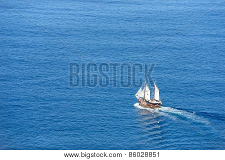Sailing Motor Boat On Bright Blue Background Of Sea Water.