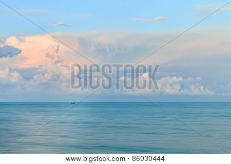 Dreamy blurred glowing sunset seascape background
