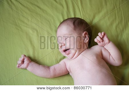 Baby Newborn Crying On Green Sheet