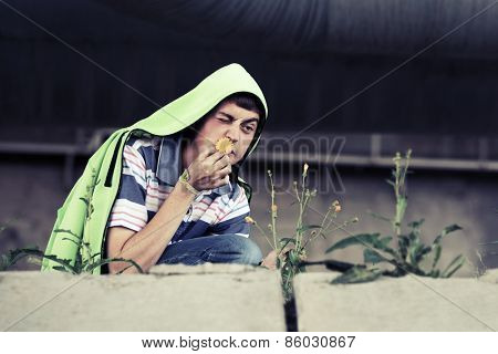 Crazy young man with a flower