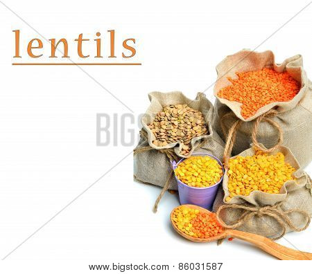 Green, Red And Yellow Lentils In The Sacks And Spoon Wooden Isolated On White