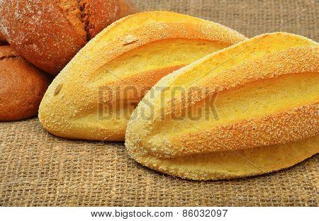 Fresh Wheat Buns On The Sacking Background.