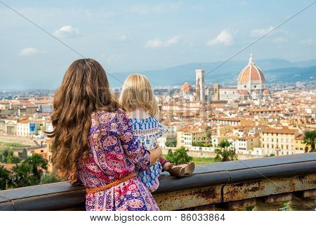 Mother And Baby Girl Looking On Panoramic View Of Florence, Ital