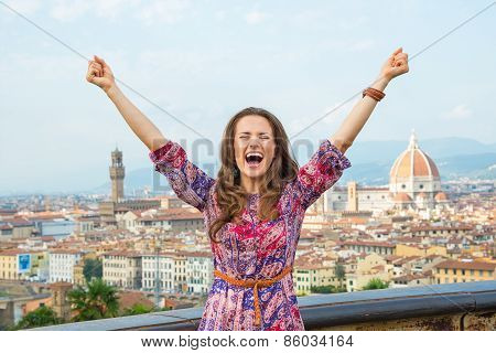 Happy Young Woman Rejoicing Against Panoramic View Of Florence,