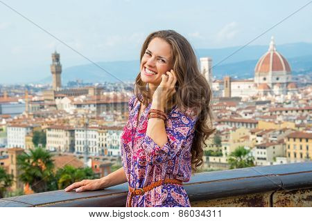 Smiling Young Woman Talking Mobile Phone Against Panoramic View