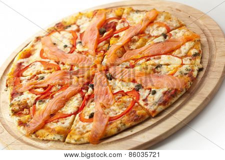 Pizza with Mozzarella, Salmon Slice, Black Olives and Vegetables