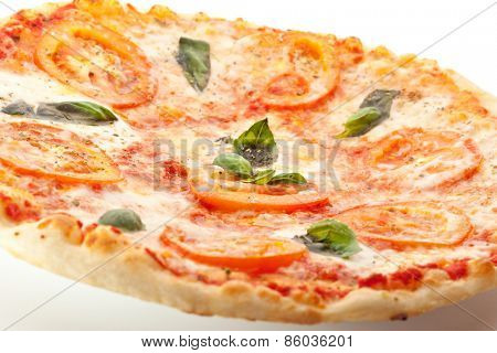 Pizza Caprese made with Mozzarella, Tomatoes, Oregano and Basil