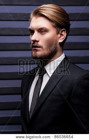 Thoughtful Handsome. Side View Of Handsome Young Man In Formalwear Looking Away While Standing Again