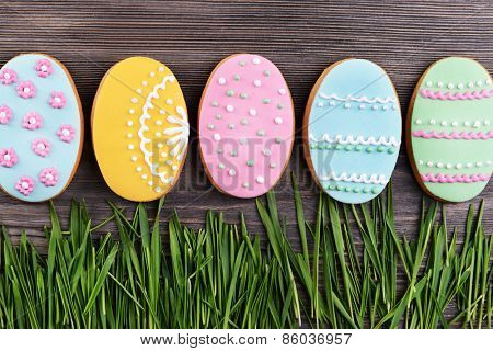 Delicious Easter cookies on wooden background