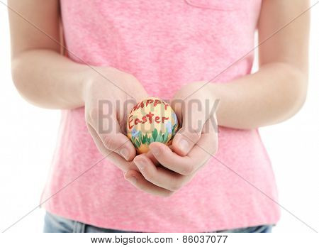 Girl holding painted egg in her hands, close-up, isolated on white