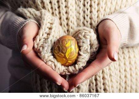 Woman holding Easter egg close up