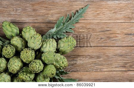 Artichokes On Aged Table, Top View