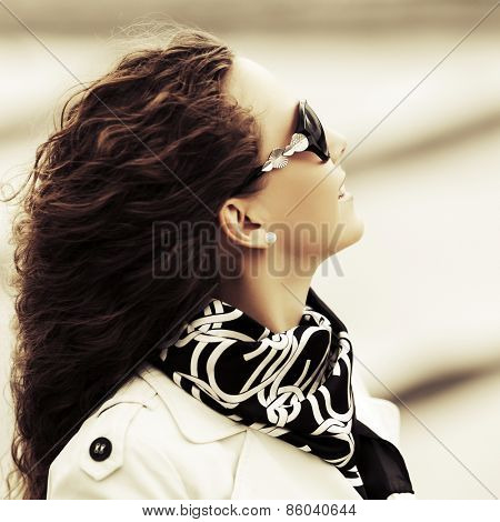 Portrait of happy fashion woman with long curly hairs outdoor
