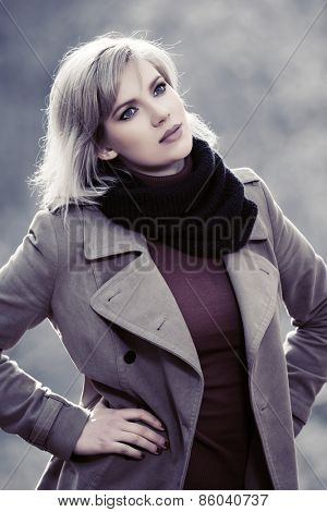 Young blond fashion woman walking outdoor