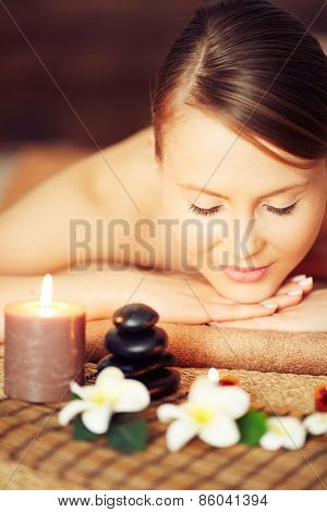 Woman enjoying therapy at spa