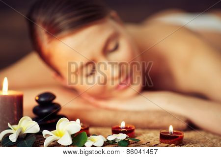 Woman lying at candles and flowers