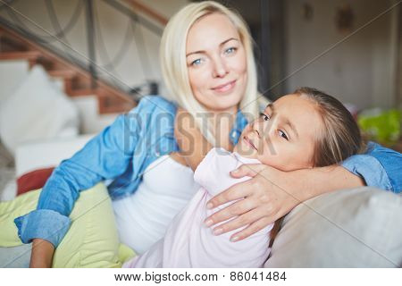 Pretty mother and daughter hugging each other