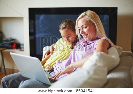 Interested family looking at laptop