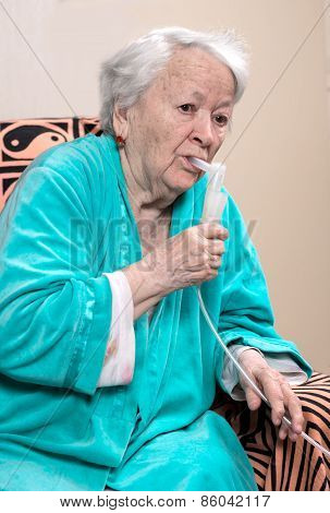 Old Woman Making An Inhalation